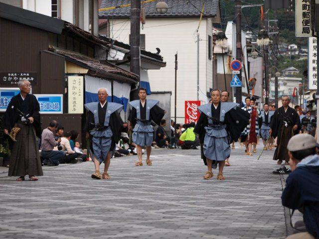 a festival near enoshima with elderly Japanese male participants
